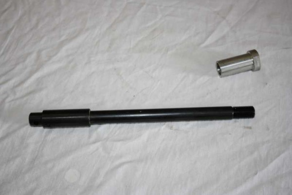 Front axle with nut